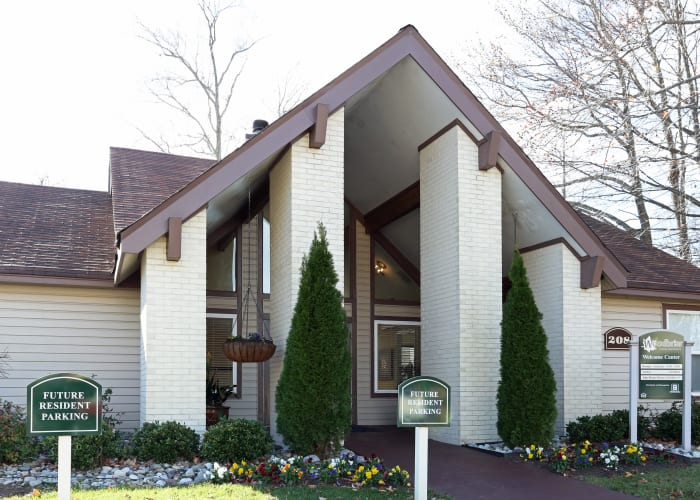 Exterior view of welcome center at Woodbriar Apartments in Chesapeake, VA