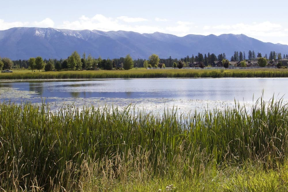 Lake and mountain backdrop at The Springs at Whitefish in Whitefish, Montana