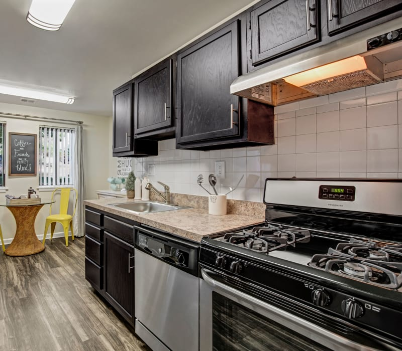 Kitchen with wood style flooring at The Gateway in Gaithersburg, Maryland