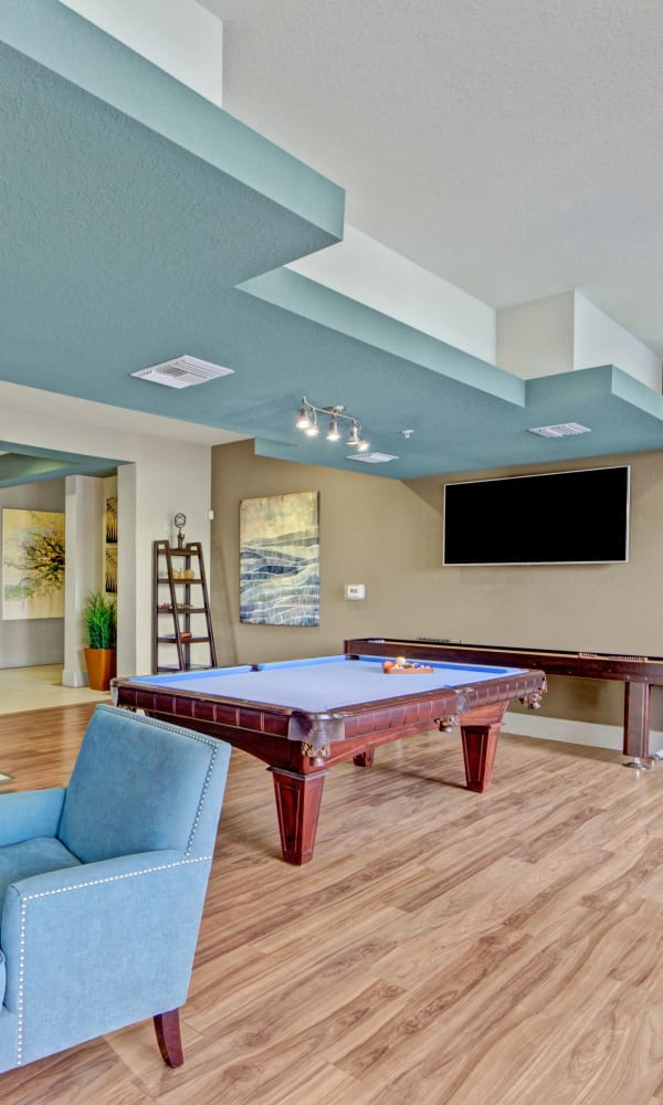 Incredible clubhouse area where residents can hang out in at The Courtney at Lake Shadow in Orlando, Florida