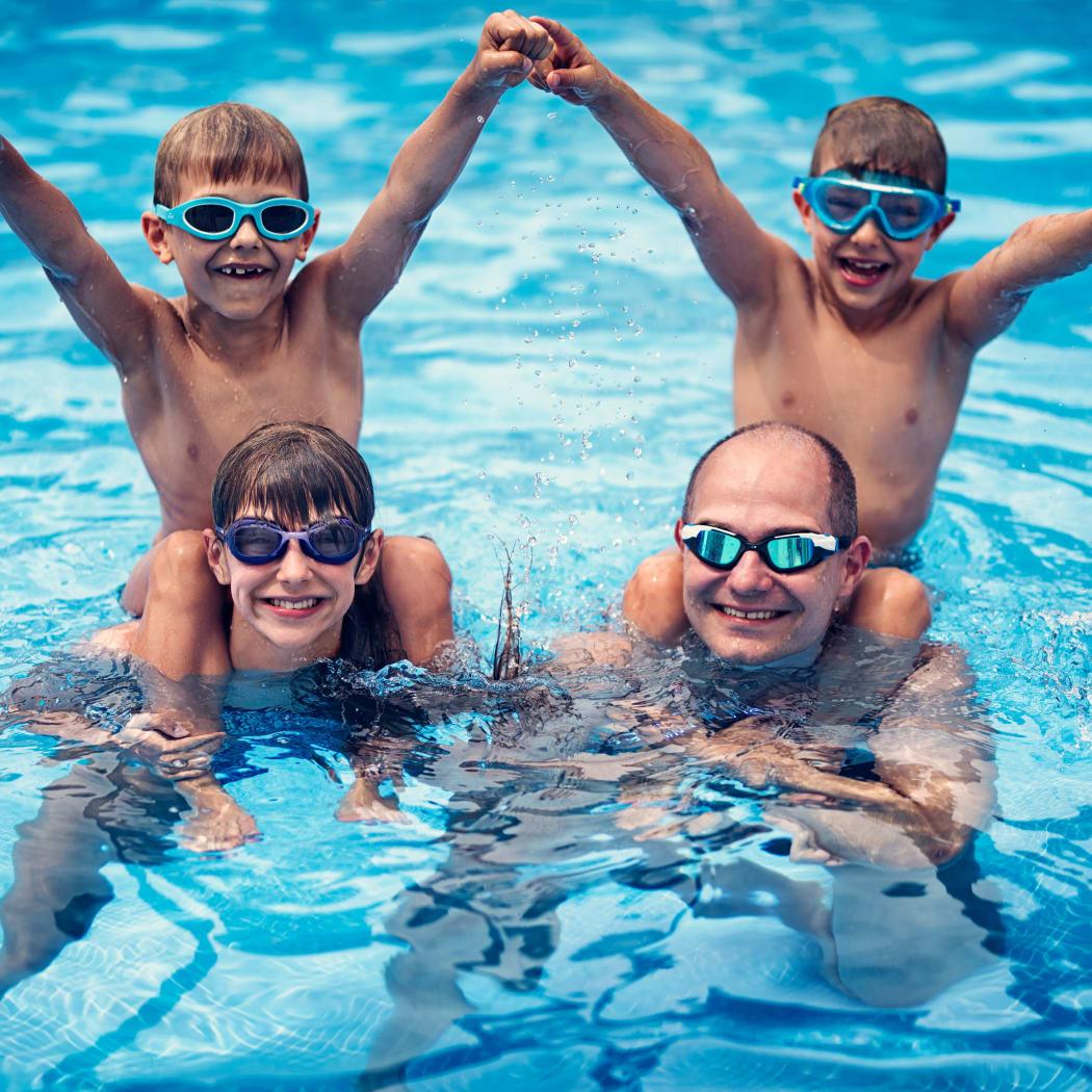 Family enjoying the refreshing swimming pool at Avilla Premier in Plano, Texas