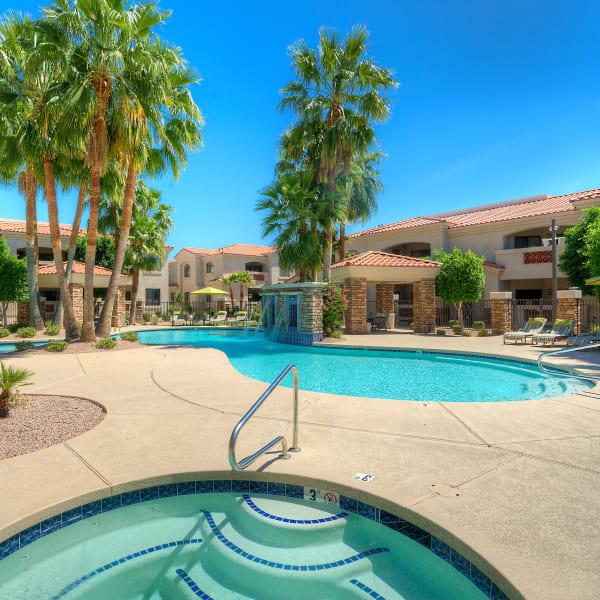 Luxurious resort-style swimming pool and hot tub at San Prado in Glendale, Arizona