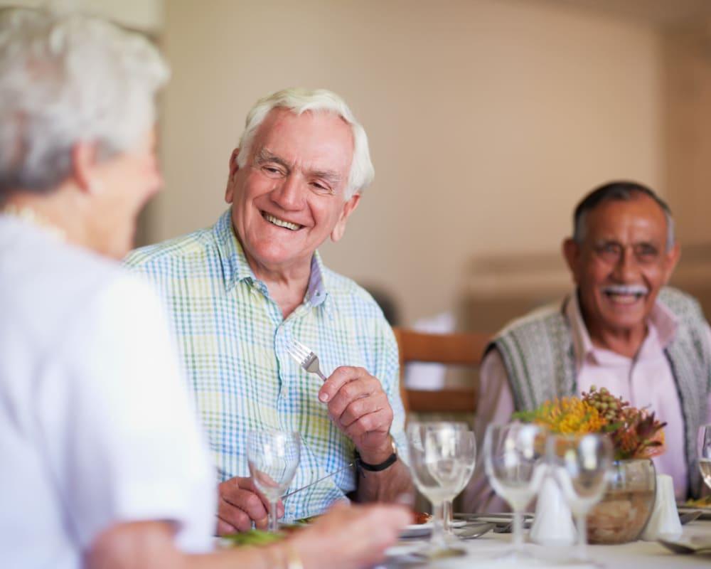 Residents enjoying a meal in the dining room at Milestone Senior Living in Faribault, Minnesota.
