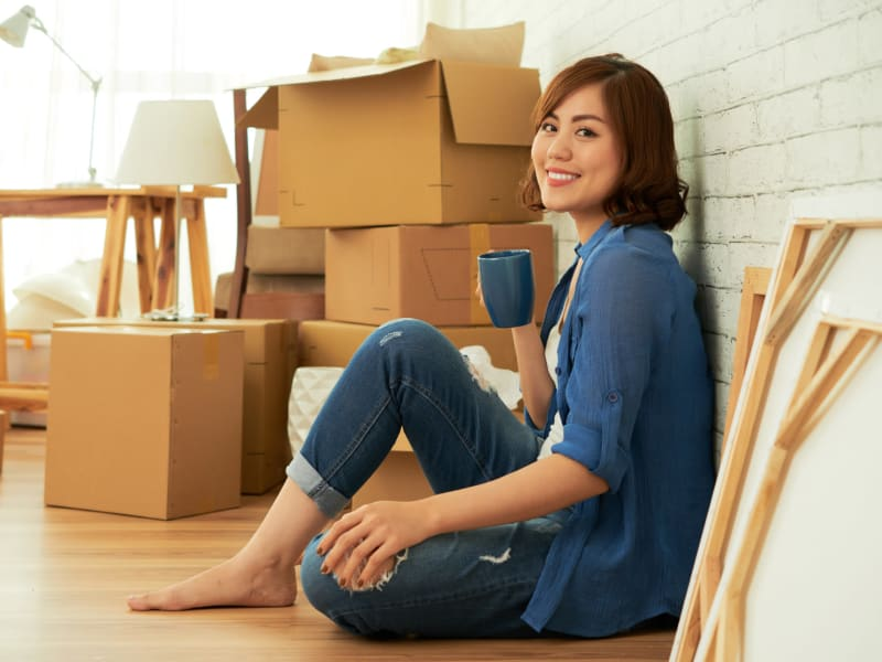A woman packing near 603 Storage - Lee in Lee, New Hampshire