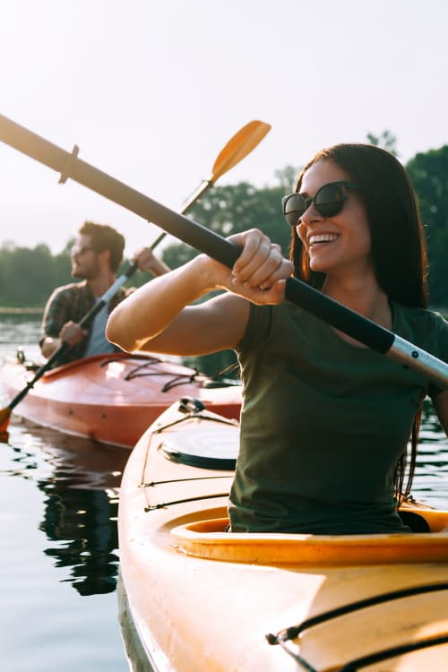 Couple on kayaks at Signature Point Apartments in League City, TX