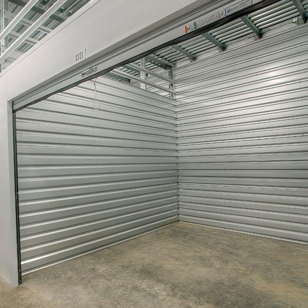 An open indoor storage unit at StorQuest Self Storage in North Miami Beach, Florida