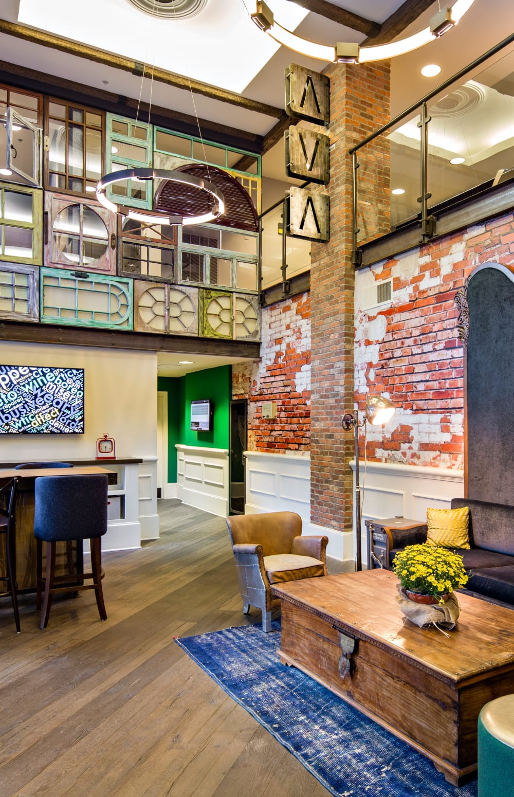 Resident clubhouse interior with exposed brick and art deco design at Sofi at 50 Forest in Stamford, Connecticut