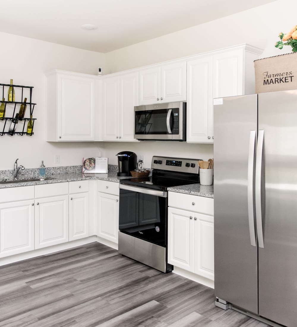 Spacious kitchen with stainless-steel appliances at Artisan Living Bella Citta in Davenport, Florida