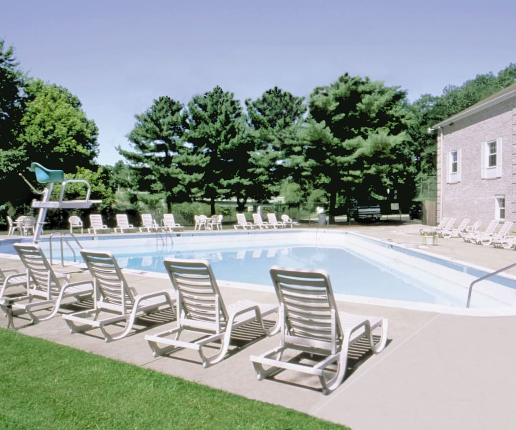 Swimming pool and chairs at The Brittany Apartments in Pikesville, Maryland