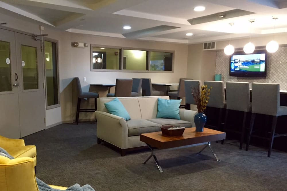 A comfortable clubhouse lounge with bar seating at Loring Park Apartments in Minneapolis, Minnesota