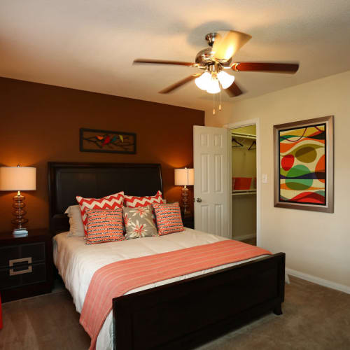 Cozy bedroom at The Abbey at Willowbrook apartments