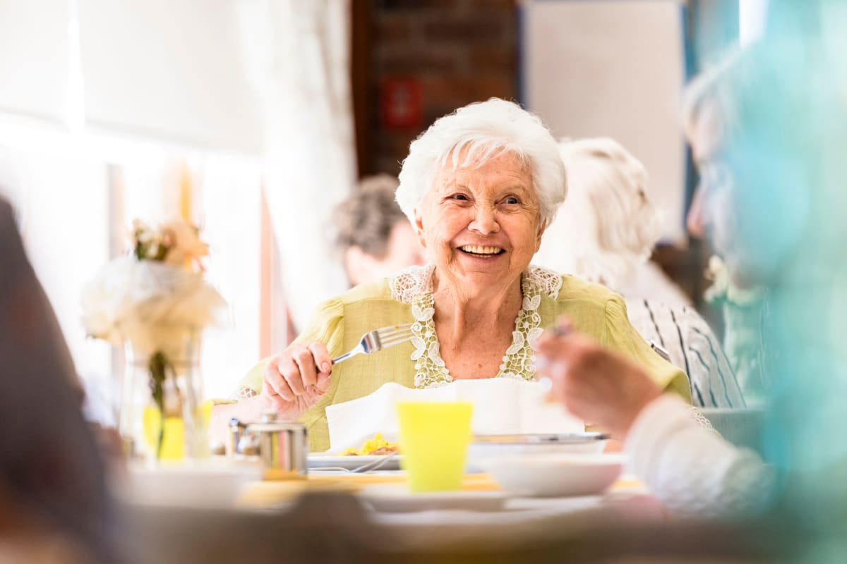 A woman with a gourmet lunch at Broadwell Senior Living in Plymouth, Minnesota