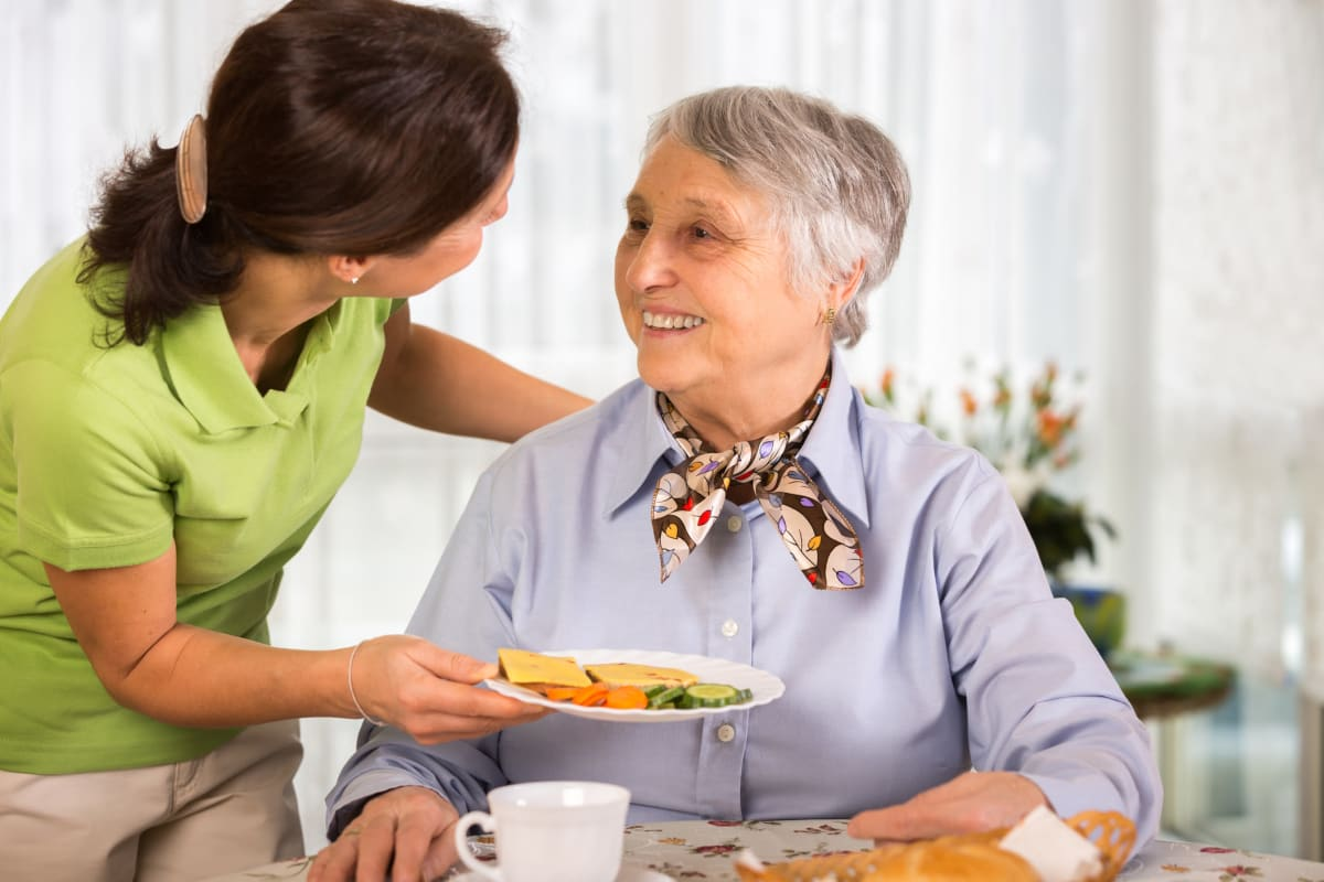 A woman enjoying a meal at Broadwell Senior Living in Plymouth, Minnesota