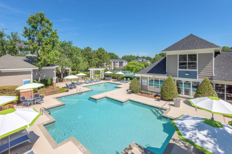Resort-style swimming pool flanked by chaise lounge chairs and lush vegetation at The Mark in Raleigh, North Carolina
