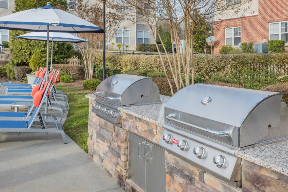 Barbecue area near the pool at The Avant at Steele Creek in Charlotte, North Carolina