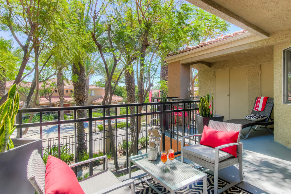 Refreshing outdoor patio space at Tuscany Village Apartments in Ontario, California