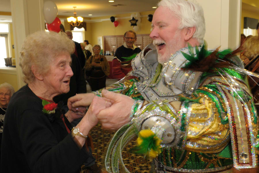 Resident dancing with a man dressed as a king at The Birches at Newtown in Newtown, Pennsylvania