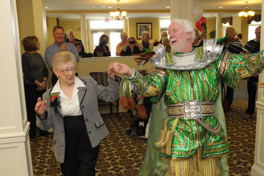 Residents dancing together at a party at The Birches at Newtown in Newtown, Pennsylvania