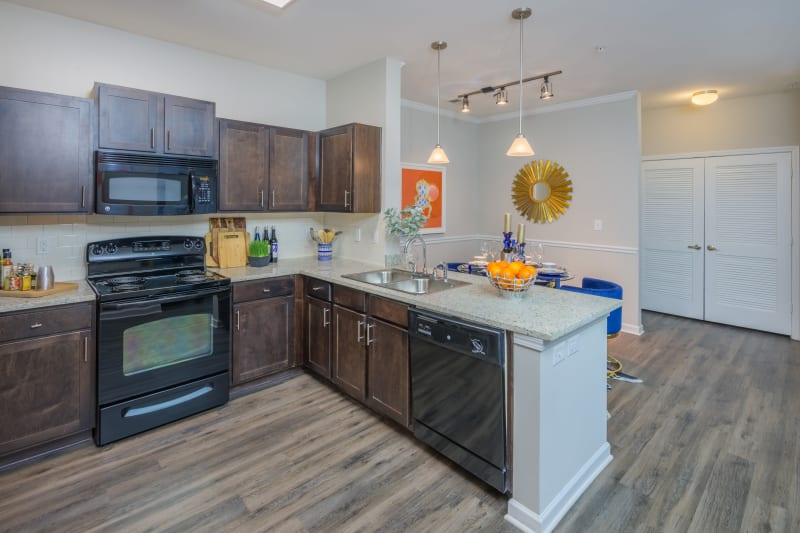 Kitchen with hardwood flooring at Sterling Town Center in Raleigh, North Carolina