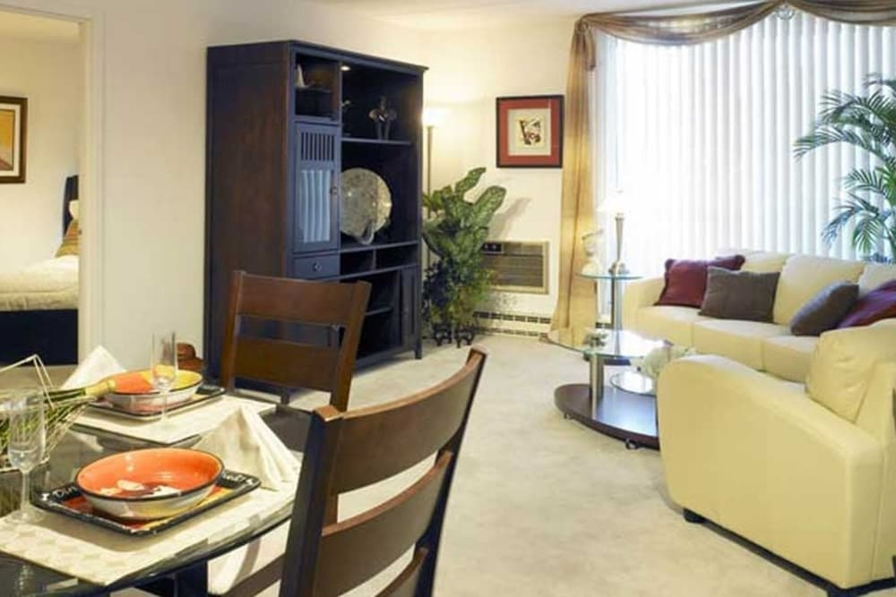 Living room and dining area at Park Towers Apartments in Richton Park