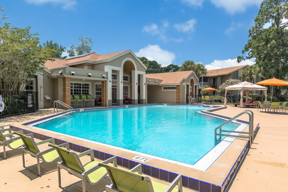 Lounge chairs to relax and enjoy the sun in poolside at The Vue at Baymeadows Apartment Homes in Jacksonville, Florida