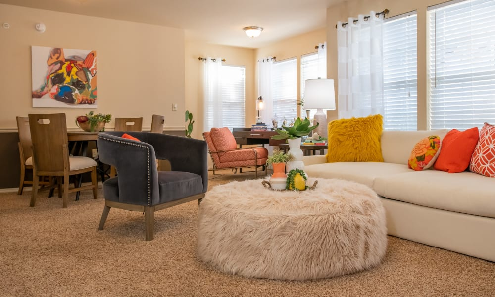 Well decorated living room with plush carpet at Mission Point Apartments in Moore, Oklahoma