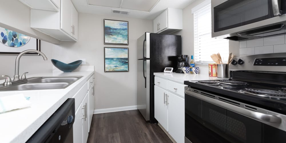 Modern kitchen with beautiful white wood cabinets at WestEnd At 76Ten in Tampa, Florida