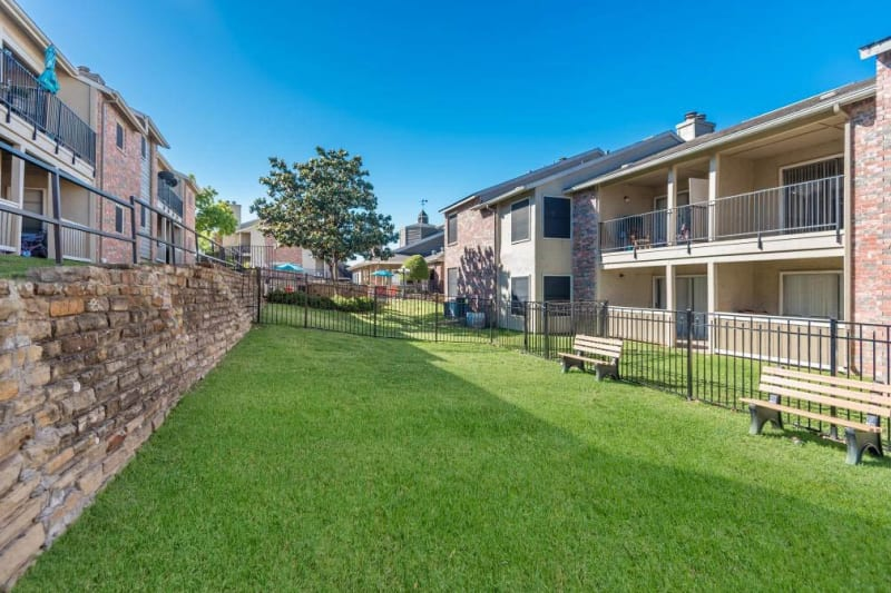 Large green grass area for residents to enjoy at The Carling on Frankford in Carrollton, Texas