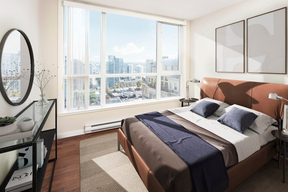 Lovely model bedroom with mirror at Metropolitan Towers in Vancouver, British Columbia