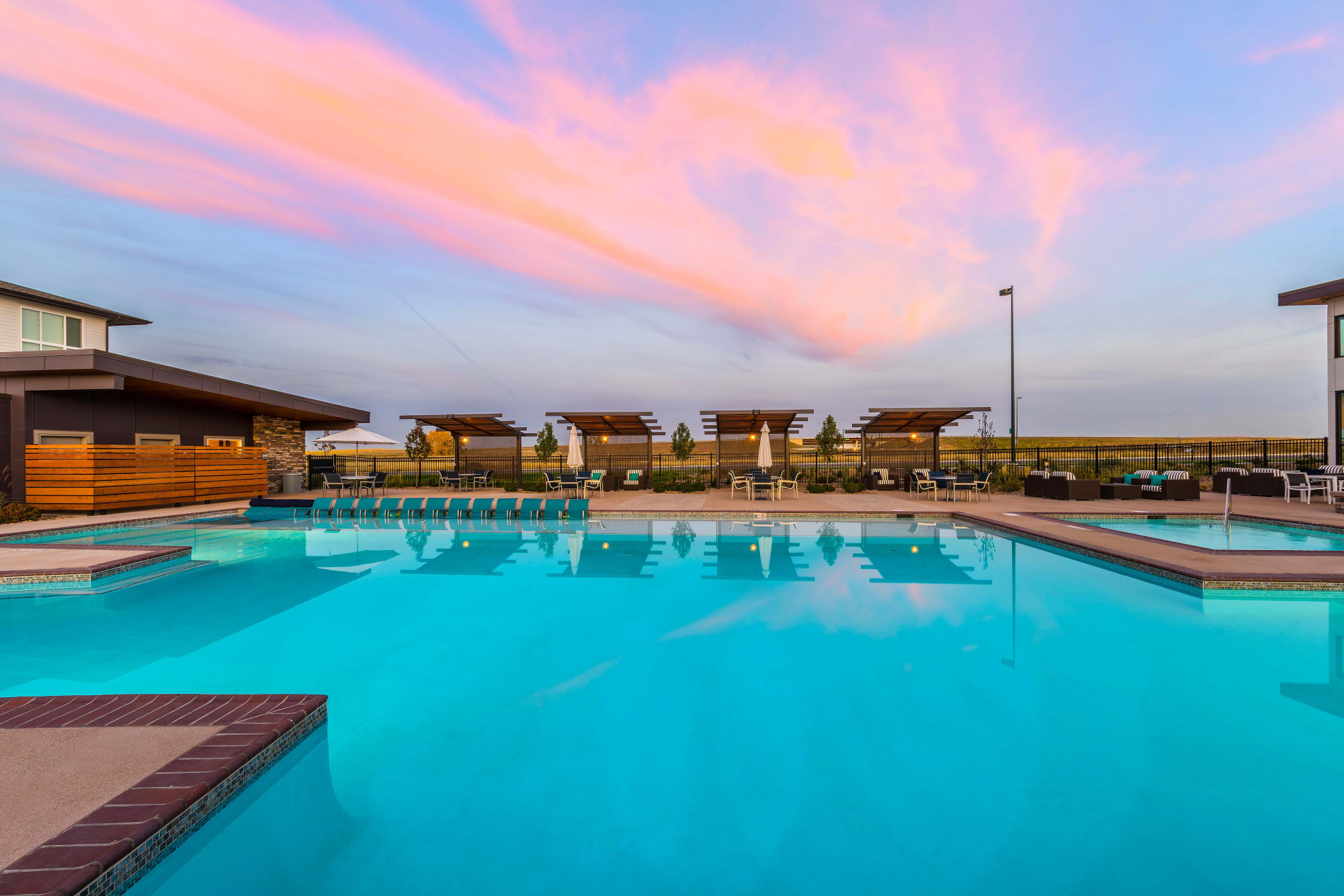 The swimming pool at Strata Apartments during a beautiful Colorado sunset
