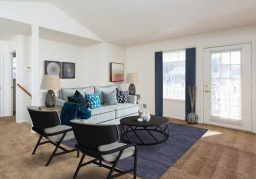 Bright, inviting living room at Westview Commons Apartments in Rochester, New York