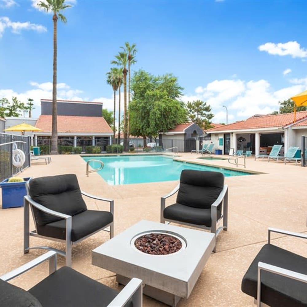 Poolside lounge chairs with a firepit at Argenta Apartments in Mesa, Arizona