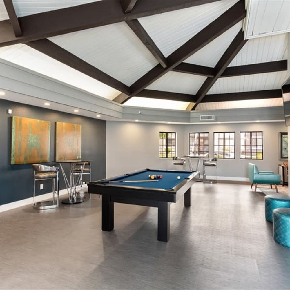 A game room with a pool table at Argenta Apartments in Mesa, Arizona