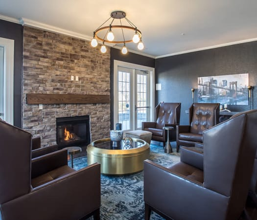 Clubhouse lounge with fireplace at Fairview at Town Center Apartment Homes in Rochester, New York