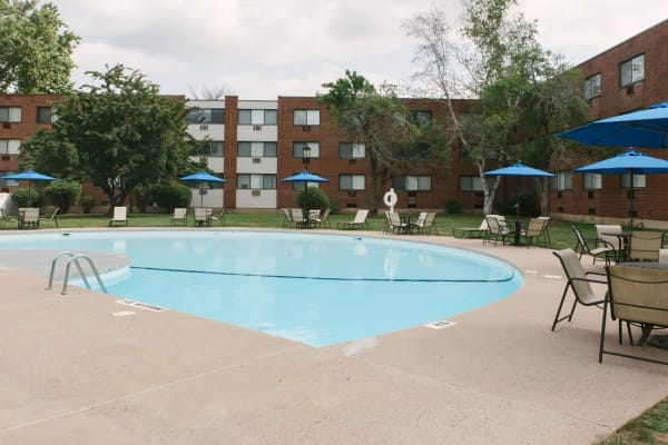 Refreshing swimming pool for residents to cool off in on warm days at Eagle Rock Apartments at West Hartford in West Hartford, Connecticut