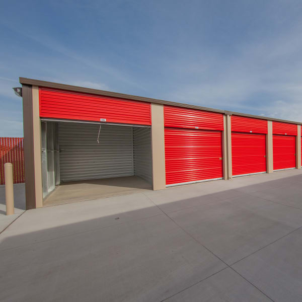 Drive-up outdoor units with red doors at StorQuest Express Self Service Storage in Phoenix, Arizona