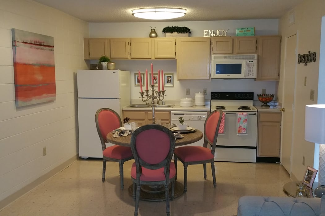 A dining room and kitchen at The Phoenix Apartments in El Paso, Texas
