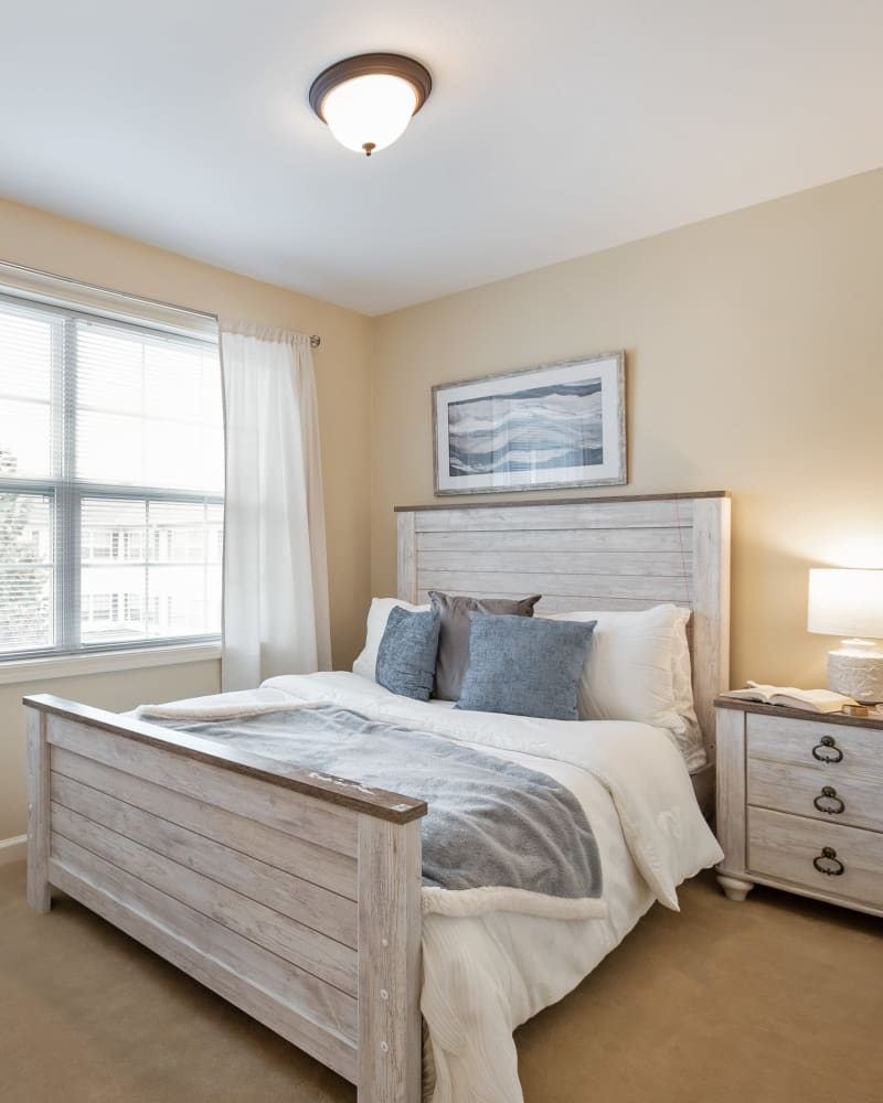 Bed in a 1 bedroom senior apartment at The Hearth at Hendersonville in Hendersonville, Tennessee