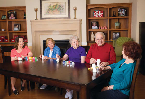 Residents enjoying an activity at The Enclave at Cedar Park Senior Living in Cedar Park, Texas