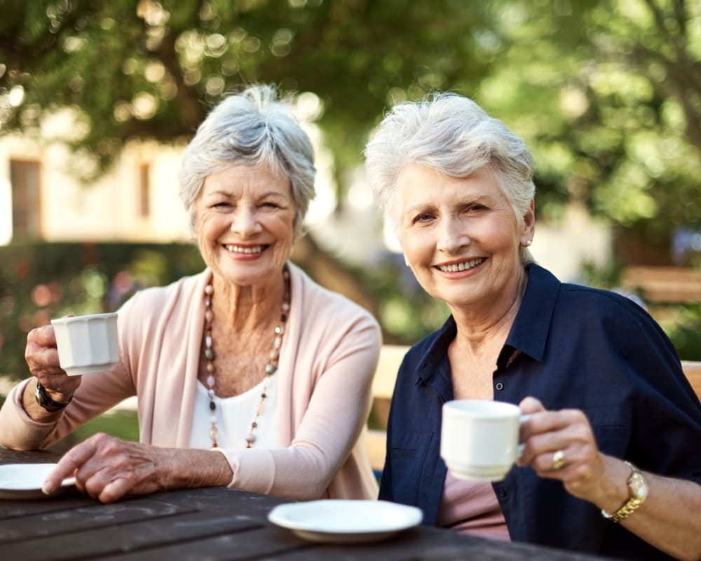 Two residents having tea outside at Welbrook Grand Montecito in Las Vegas, Nevada