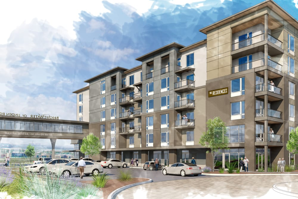 A rendering of the front entrance with cars parked in the front at The Courtyards of Linden Pointe in Winnipeg, Manitoba