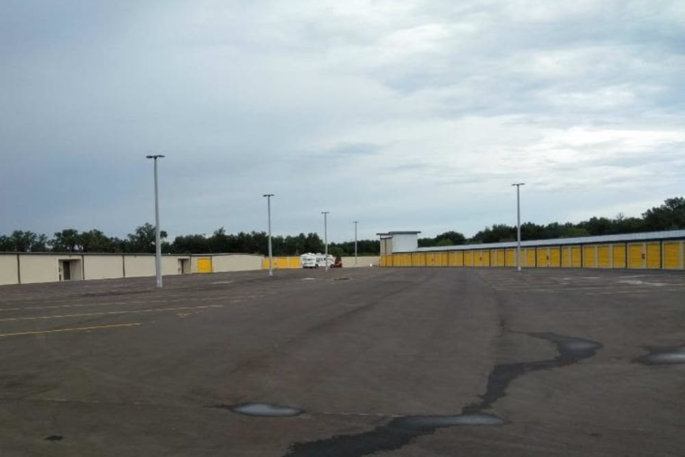 The parking lot and storage units with yellow doors at Stor 4 Dayz in Sanford, Florida