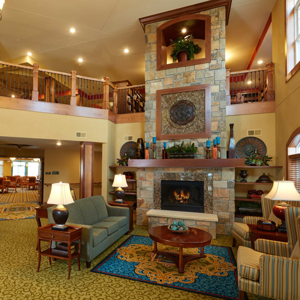 Lobby with a fireplace at Applewood Pointe Bloomington at Valley West in Bloomington, Minnesota.