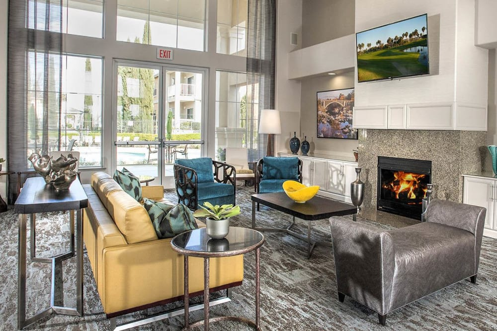 Large clubhouse with a fireplace at Iron Point at Prairie Oaks in Folsom, California