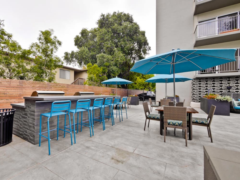 Barbecue area with shaded seating at Mia in Palo Alto, California