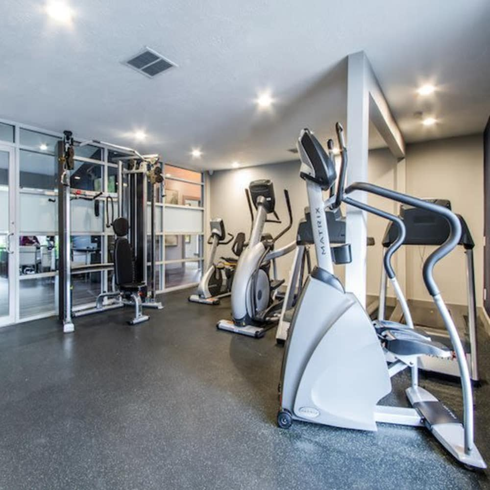 Equipment in fitness center at Carmel Creek in Houston, Texas