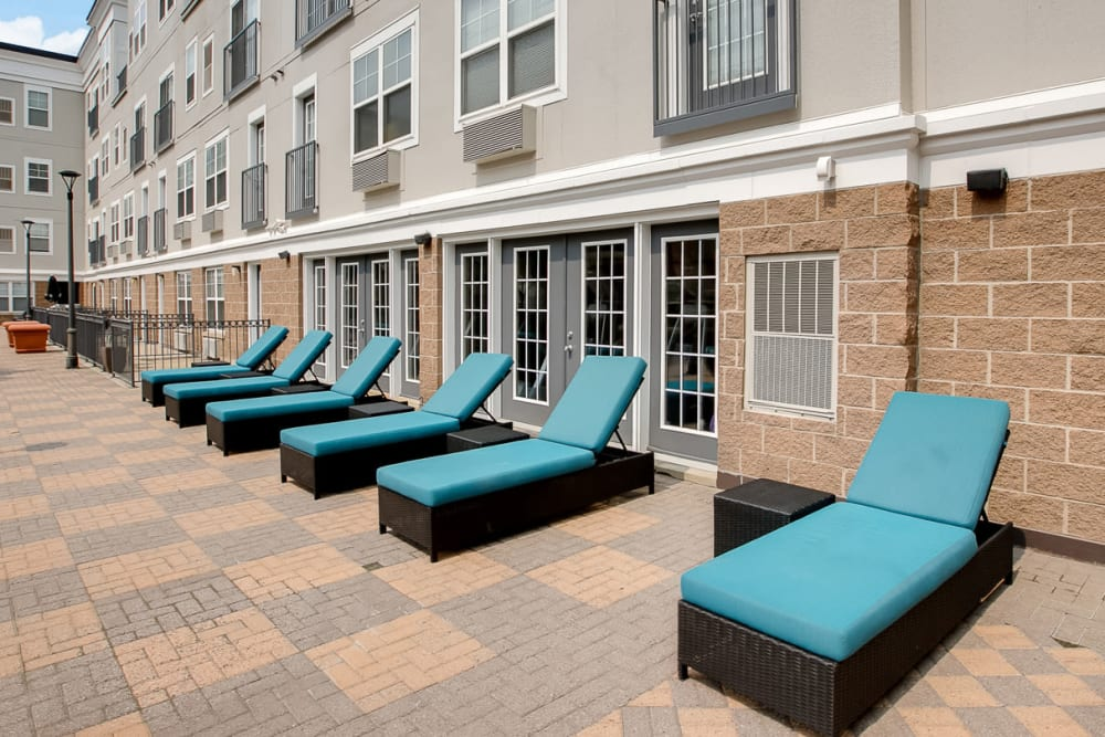A sundeck with comfortable lounge chairs at Loring Park Apartments in Minneapolis, Minnesota