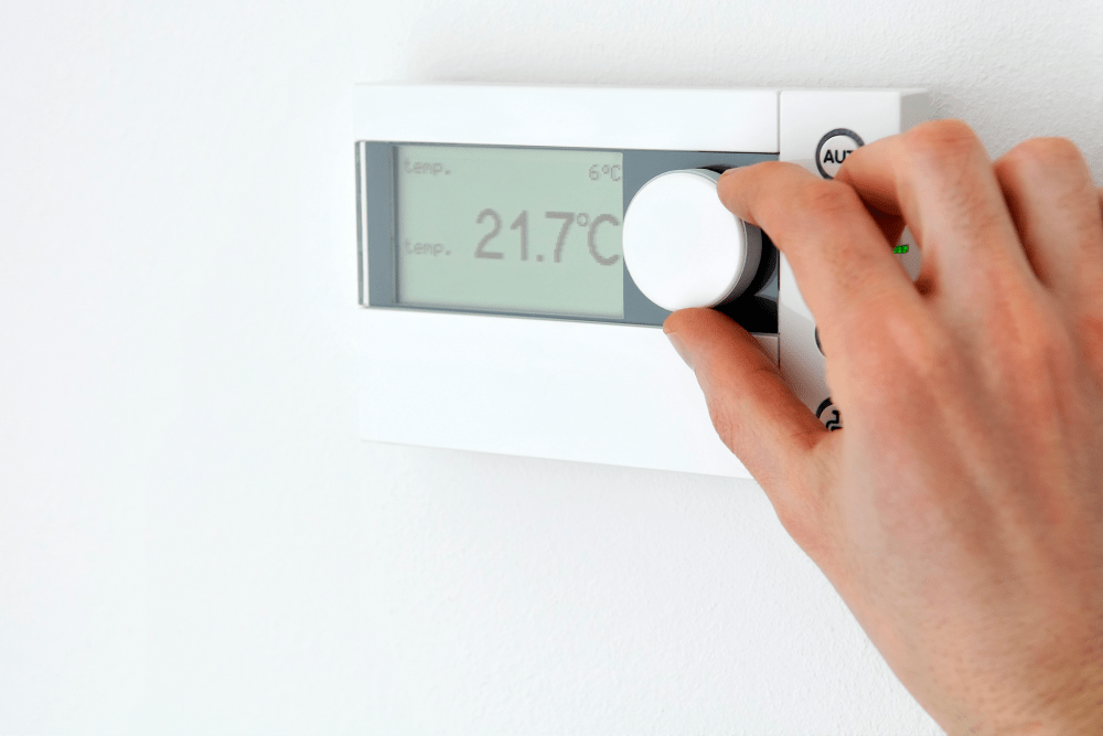 Adjusting a thermostat for climate controlled storage at A-American Self Storage in Lancaster, California