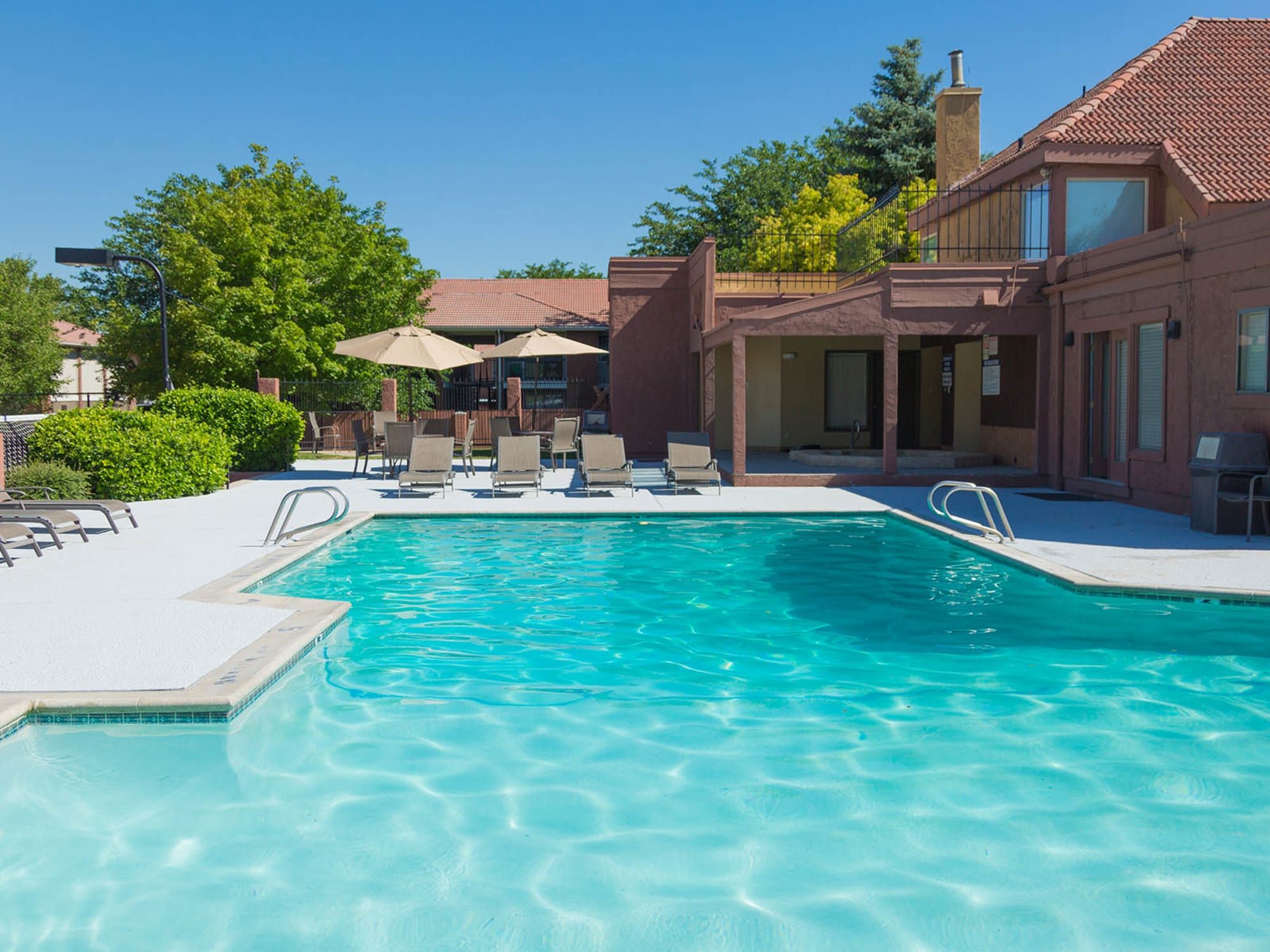 Sparkling Pool and deck with lounge chairs in West Valley City, UT