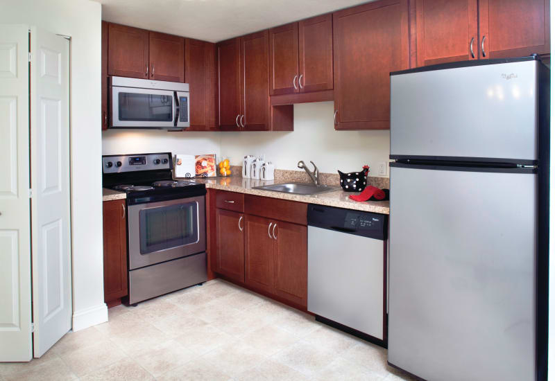 Kitchen with stainless steel appliances at The Village at Marshfield in Marshfield, Massachusetts